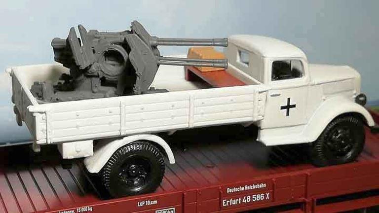 RUSAM-OPEL-BLITZ-10-953 Автомобиль Opel Blitz с зенитным орудием (четыре ствола, зимний камуфляж), 1:87, 1939—1945, Wehrmacht